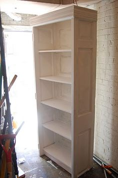 Old Door Bookcase..love the inset panels shown on sides and back of bookcase...