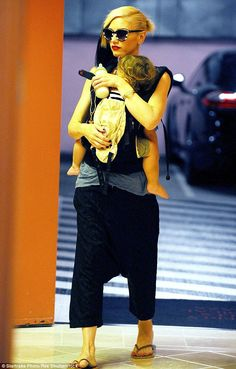 Cute and casual: Gwen teamed cropped harem pants with a grey sleeveless shirt...