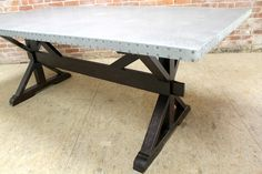zinc trestle table with x-base  made by  the artisans at www.ecustomfinishes.com