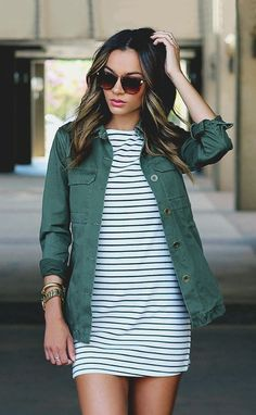 love the look of the army green jacket over the striped dress / cute and casual