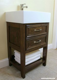 Build a small vanity with an IKEA sink -- and it has both open storage on the bottom AND a hidden storage cabinet behind two false drawer fronts. Ikea Hack Vanity, Ikea Hack Bathroom, Ikea Bathroom Vanity, Cosy Bathroom, Large Bathroom Mirrors, Ikea Sinks, Diy Vanity, Diy Bathroom Decor, Bathroom Storage