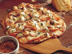 Seafood pizza with shrimp and scallops.