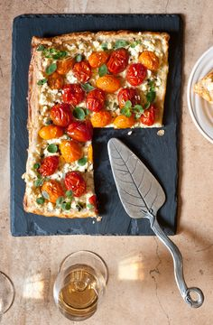 Cherry Tomato & Feta Tart, local heirloom cherry tomatoes and feta on a puff pastry crust.