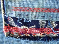 stitches on mended jeans