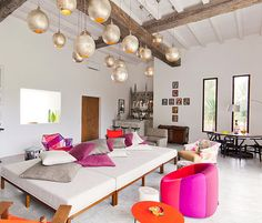 Love the fuchsia and purple colours to break up the white. The beams are luscious AND check out the bar at the back