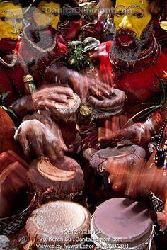 Huli wigmen beating kundu drum and dancing at Sing Sing Festival, Mt. Hagen, Papua New Guinea.