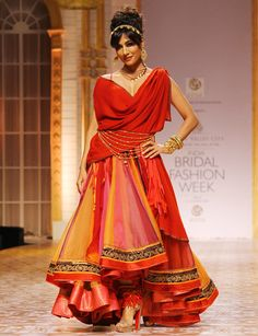 Showstopper Chitrangada Singh lent her regal aura to the Avza line which was dominated by red and black colours and gold accents. Source: rediff.com