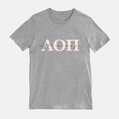 Our blush sorority t-shirt features your sorority's letters in blush + your sorority's name in modern calligraphy script on a heather gray t-shirt! Greek tees are made from a comfy 40% Polyester and 60% cotton blend.