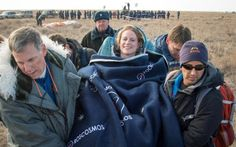 International Space Station American astronaut Kate Rubins of the NASA is carried to a medical tent shortly after she landed aboard the Russian Soyuz MS-01 spacecraft near Zhezkazgan, Kazakhstan.