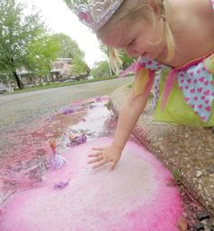 Magical rainy day puddle play with MAGIC bubbling puddles - SUPER FUN rainy day activity for kids that explores sensory play, art, science, imaginative play, and more! ~ Growing A Jeweled Rose