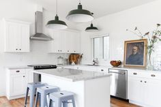 """The design for the kitchen is """"clean and simple,"""" much like the entire house. The light fixtures are from Barn Light."""