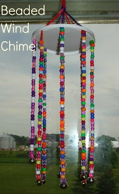 Beaded Wind Chimes Ideas - Using a recycled plastic lid, some yarn, pony beads and bells you can create thi. Crafts To Do, Crafts For Kids, Arts And Crafts, Craft Activities, Preschool Crafts, Rainy Day Activities For Kids, Bonding Activities, Wind Chimes Kids, Kids Craft Tables