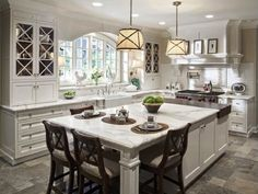long kitchen island with seating | Wide Kitchen Islands with Seating and Marble Top Placed near Long ...