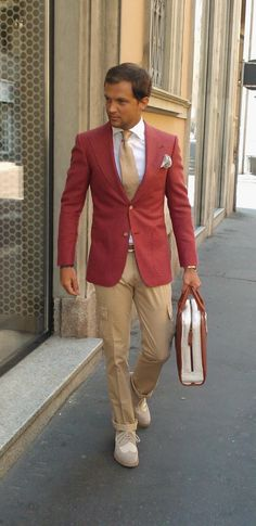 there's a lot going on here that i like. red jacket over neutral colors, peak lapels with a wide knit tie to match, pocket square, bag, shoes. i'm still undecided on slim cargos though.