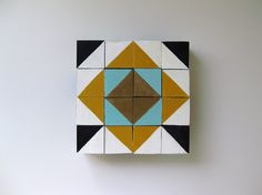 Great idea for hand-painted blocks:  http://blog.landofnod.com/honest-to-nod/2012/05/hand-painted-geo-blocks.html