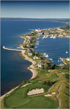 Bay Harbor, MI - once nothing but a cement plant, Bay Harbor began it's transformation in the 90's into a playground for the rich with a yacht club, golf course, boutiques, hotels, lavish lake homes and an equestrian center.