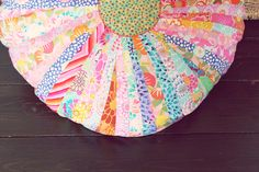 """DIY Colorful Floor Cushion from scraps of fabric or you can use fabric from a """"Jelly Roll"""" (has coordinating 2 1/2"""" x 42"""" strips of fabric)"""