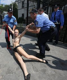 """Russian president's plans to divorce his wife not to everyone's liking  Naked activist Femen held a rally against Putin's divorce near the Russian Embassy in Kiev (PHOTOS, VIDEO)  """"Putin has officially renounced in favor of the Customs monogyny harem"""""""