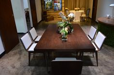 Mid-century walnut farm table and chairs. Amp up your next event!