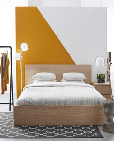 3 Bedroom Themes For Maximum Comfort A Simple Clean Bedroom With A Graphic Orange And White Wall Bedroom Themes, Bedroom Styles, Bedroom Decor, Bedroom Lamps, Wall Decor, Bedroom Orange, White Bedroom, Clean Bedroom, Bedroom Simple