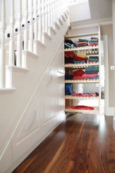 Make the most out of every inch of storage space.  These incredible pull-outs under the stairway can store linens, toys, or get any kind of clutter out of eye-sight.