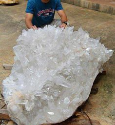 Lemurian Seed Crystal Cluster from Serra Do Cabral Mountain, Brazil! Lemurian Quartz crystal are also known as Lemurian Seed crystals and are mainly found in Brazil, Tibet, Russia, Zambia and the USA. These crystals may be in a range of colors including clear, smokey, green, pink, blue, citrine,  and apricot..Many have a light coating of iron oxide which may be the reason for the coloring of some specimens.