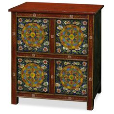 Hand-Painted Tibetan Chest.  Adopted from Tibetan art, this cabinet is uniquely hand painted with cheerful floral motif design. Ample storage space behind four doors for your storage convenience. Tibetan furniture.