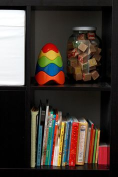 Nursery Shelf Styling - love the jar of wooden blocks!