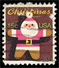Image of old cancelled US Christmas stamp showing santa claus image