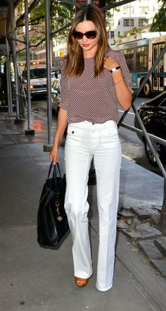 Pair patterned tops and sunglasses with bright white boot-cut pants for an elegant summer look!
