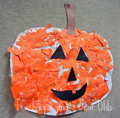 cut scraps of orange paper and glue on paper to make pumpkin