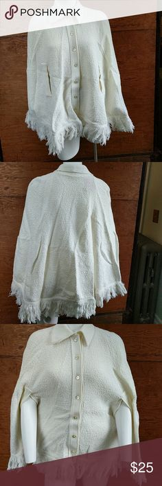 """Cream Vintage Boho Hippie Poncho Fringe 1970s This cream colored poncho is in Excellent Used Condition.  Length 28"""" 3""""Fringe 7 buttons This would look great with leggings, tall boots and a dark tank underneath. Vintage Sweaters Shrugs & Ponchos"""