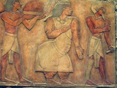 Relief from Dayr al Bahri temple showing Queen Eti of Punt with her husband Perehu as they welcome the delegation by sea of Queen Hatshepsut. 15th c. B.C. Punt was a Pygmy kingdom or chieftainship on the Somalian or Eritrean Coast, of uncertain location. Kemet had friendly relations with it by sea, and traded with Punt for myrrh and other exotics. Initial maritime contact was in the Fifth Dynasty, and then renewed at the time of Hatshupset, lasting to the 12th century B.C.