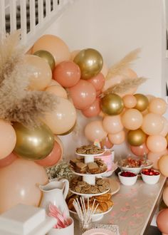 fairy garden boho birthday party with peach balloon garland