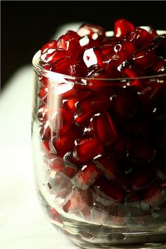 Pomegranates like rubies in a glass