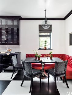 In the breakfast area of a Manhattan duplex decorated by Steven Gambrel, a Julian Chichester table base with a granite top is paired with custom-made chairs cushioned in an Osborne & Little fabric.