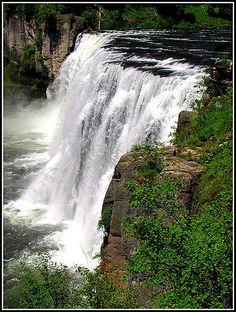 Upper Mesa Falls in Eastern Idaho is on the Henry's Fork section of the Snake River.   It falls 114 feet and is 200 feet wide. Nearly 1 billion gallons flow over it per day at its peak.  Summer is a good time to go.  Easy hike from the road and about an hour from Idaho Falls. Spectacular and amazing though not that widely known outside the state. Just  a half mile down the road the lower falls is also nature and tourist site you must stop at.  Keep an eye out for black bears, we saw one n...