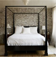 Exposed brick bedroom wall
