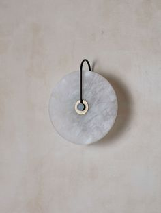 A scaled version of our Aperture Sconce with an Alabaster diffuser. Under in depth to meet standards of the Americans with Disabilities Act for commercial walkways.Handcrafted in the USA. Bathroom Vanity Lighting, Bedroom Lighting, Interior Lighting, Cool Lamps, Front Entrances, Maker, Pendant Light Fixtures, Nordic Design, Metal Finishes