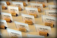 Candlelight Wine Themed Wedding Centerpieces | Cute wine cork holders for place cards. I love the messages written on ...