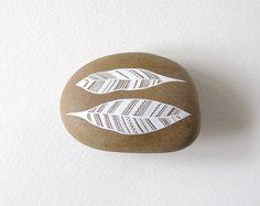 Two Feathers - Hand-painted beach pebble.  © Natasha Newton 2012