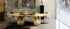 Dining Table by Boca do Lobo | The Fortuna Dining Table is a shimmering statement piece that unites Boca do Lobo's one of a kind design aesthetic and passion for Gold. Representing the essence of empowerment, sophistication, mystics, and enticement, the Fortuna features a one of a kind design, with a unique table surface texture and incredible finish. | www.bocadolobo.com #luxuryfurniture #diningroom #interiordesign #moderndiningtable #diningtableideas