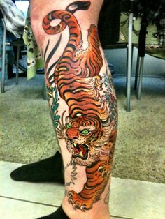 Tiger by Brian Burk. Fucking BADASS. Seriously, why do people get tattoos of anything other than tigers?