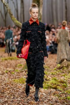 A hint of red. Chanel longline coat with red collars and pipes for Fall 2018. Paris fashion week PFW