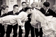 Another awesome idea: Bridal party holding up Bride and Groom. (Source: True Photography)