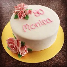 80th birthday cake with hand made sugar roses.