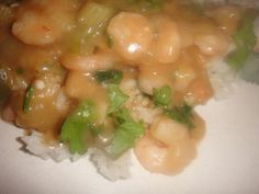 CRAWFISH or SHRIMP ETOUFFEE ** celery, onion, green pepper, simmered in a rich sauce and served over white rice * touch of heat ** New Orleans and MARDI GRAS specialty