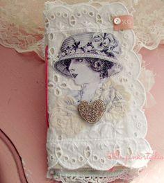Little Pink Studio blog http://littlepinkstudio.typepad.com/little_pink_studio/2013/03/a-mini-book-.html