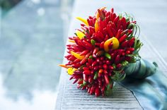 A beautiful non-bloom #bridal bouquet! This one is made with chili peppers - how unique!   From Chiara Clemente and Tyler Thompson's Wedding on the Amalfi Coast – Vogue