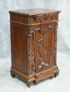 Carved walnut Victorian music cabinet in the Aesthetic style